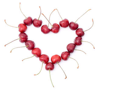 red shape heart from sweet cherry with white background, left handed position, copy space for the text Stock Photo - 3247682