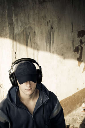 young man listening music in headphones, grunge photo, copy space for text Stock Photo - 3324786