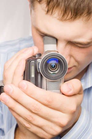 closeup man portrait with videocamera Stock Photo - 3444706