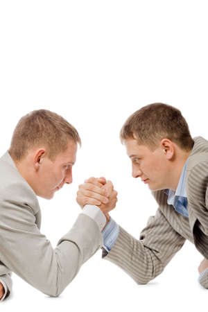 two men wrestling with arms, concurention fight business concept, white background photo