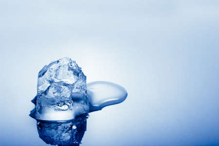 blue toned: one cold blue toned ice cube, copy space for text Stock Photo