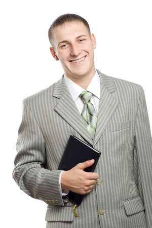 young adult smiling businessman holding black book photo