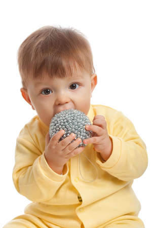 little boy eating toy, on white background photo