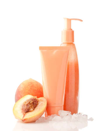 cosmetics with ice and peach fuit, isolated on white