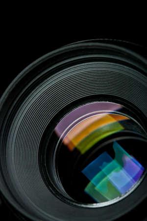 closeup camera lens on black background