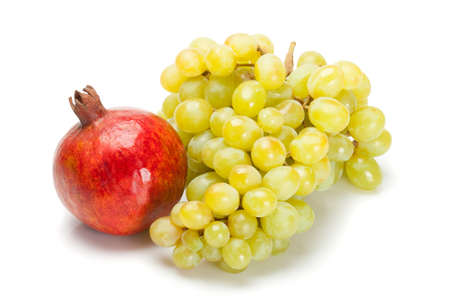 isolated pomegranate and grape on white Stock Photo - 4496528