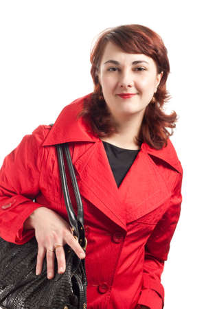 eather: portrait of woman in red coat with black eather bag Stock Photo