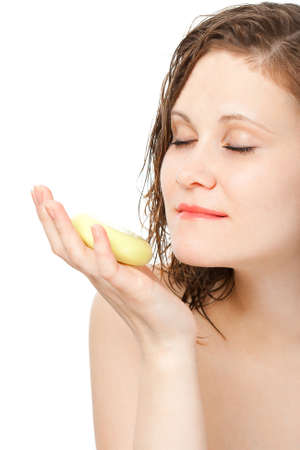 woman with bar of soap laying on hand photo