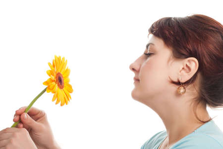 woman portrait profile with yellow gerber flower in hands photo