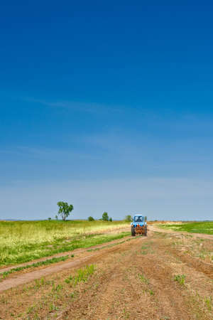 tractor going to the fields Stock Photo - 4992354