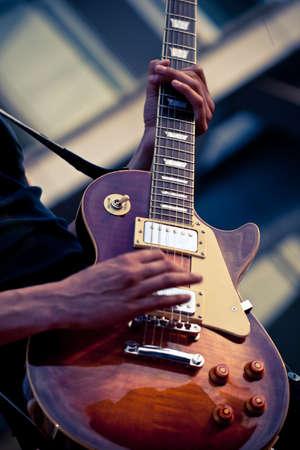 closeup electric guitar on concert