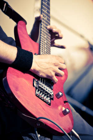 red guitar in man hands photo