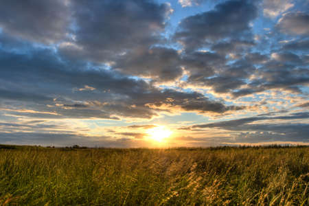 foul: sunset over the field, foul weather Stock Photo