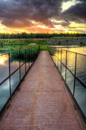 iron rusty bridge under sunset photo