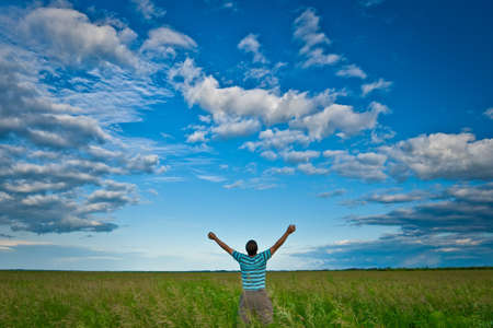 man in green field under blue skies Stock Photo - 5772972