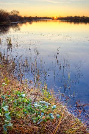 autumn sunrise on the lake photo