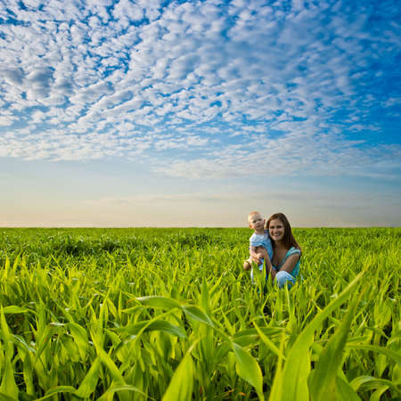 mother and her little boy in the field photo