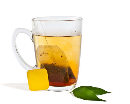 isolated hot tea in transparent glass cup with label