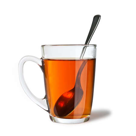 isolated cup of tea with spoon photo