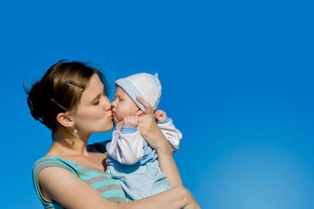 mother kissing her little son photo