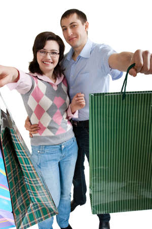 young adult couple shopping on white background Stock Photo - 6309620