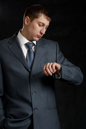 businessman looking to watch on black Stock Photo - 6357190