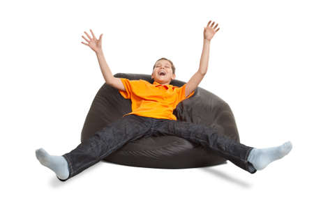 pouffe: happy teenager sitting on pouffe isolated