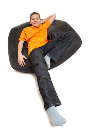 pouffe: teenager on pouffe isolated on white Stock Photo