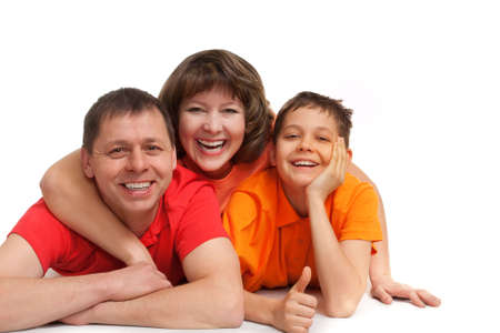 funny family studio portrait laying on the floor photo