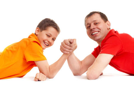 joyful guys playing arm wrestling photo