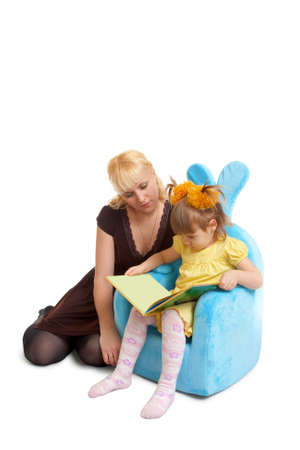 mother and daughter reading book over white photo