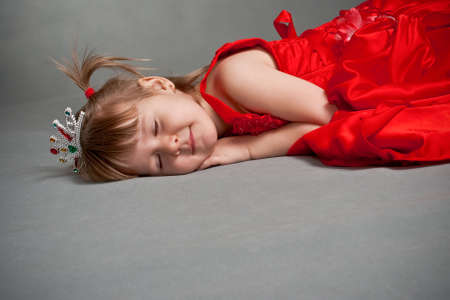 sleeping princess in red dress photo