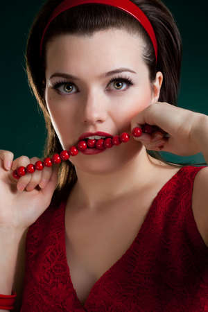 woman in red bite the red  beads photo