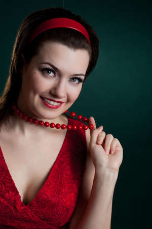 woman touching beads and smiling over green photo