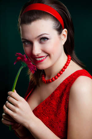 woman closeup portrait with flower over green photo