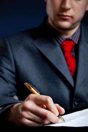 busineeman hand in focus signing contract photo