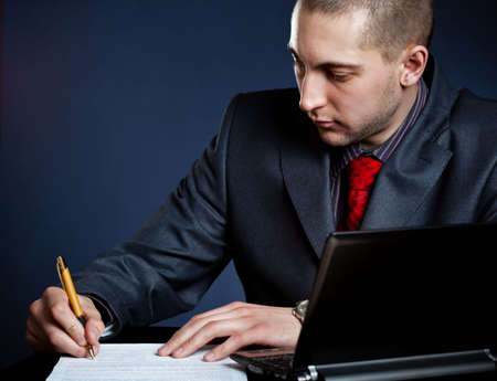 businessman signing document photo