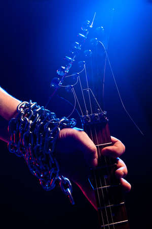 closeup hand with guitar over blue Stock Photo - 6838699