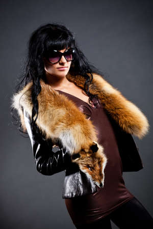 woman posing wearing leather jacket with fox fur photo