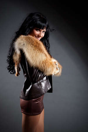 beautiful woman wearing leather jacket with fur photo