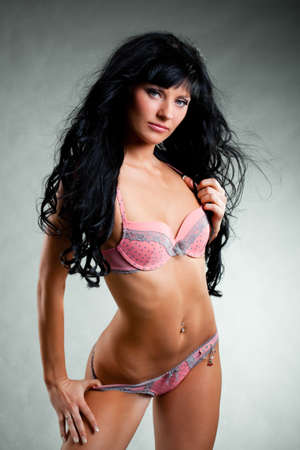 sexy woman wearing underwear over gray photo
