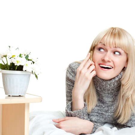 joyful woman talking by phone over white Stock Photo - 7071381