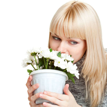 woman dreaming and holding flowers over white photo