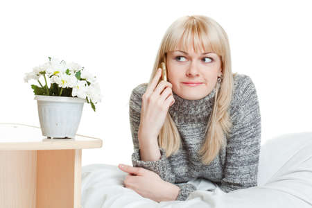 woman talking by phone laying on bed Stock Photo - 7071392