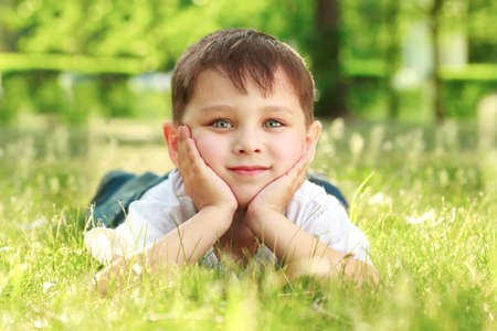 boy laying o the grass Stock Photo