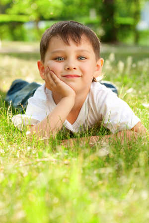 laying on the grass little boy photo
