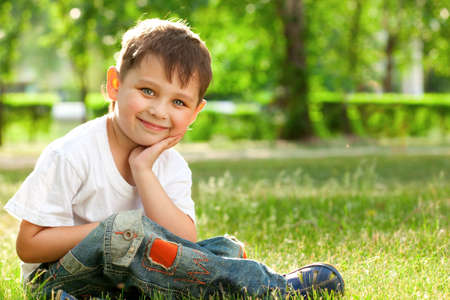 young boy smiling: little boy portrait in the park Stock Photo