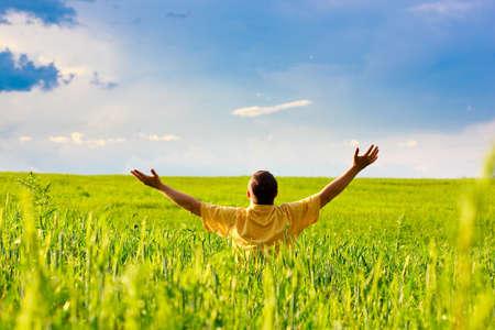 man in sunny field under blue skies photo