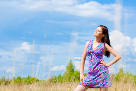 woman outdoors portrait with blue skies backround photo