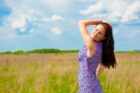 beautiful woman portrait in the field photo
